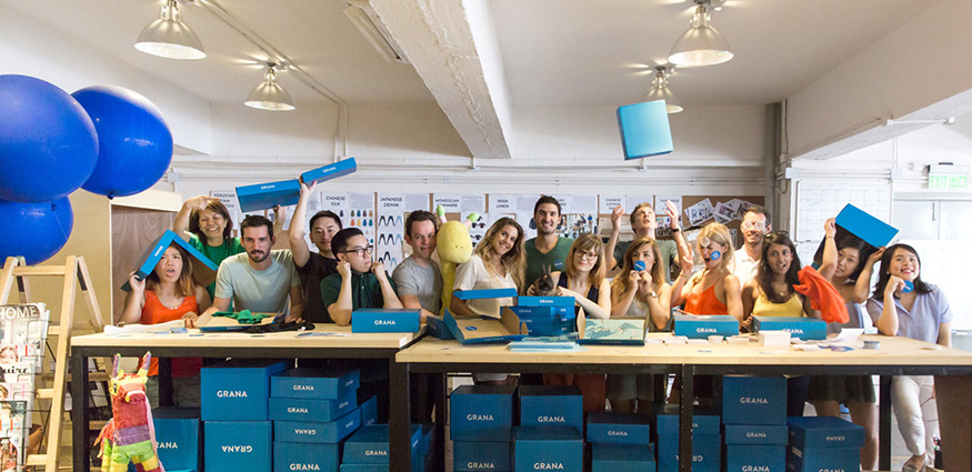 Grana group photo of team packing orders