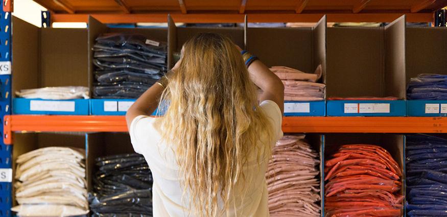 Employee getting shirt from warehouse
